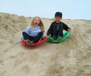 Sand sledding kids at Venice Beach