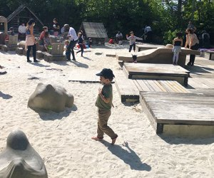 Sandbox Village at Brooklyn Bridge Park's Pier 6 is a sand city with playhouses and and a water spray area. Photo by Diana Kim