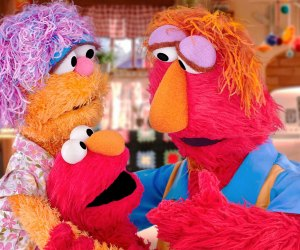 Elmo and his parents on Sesame Street. Image courtesy of PBS