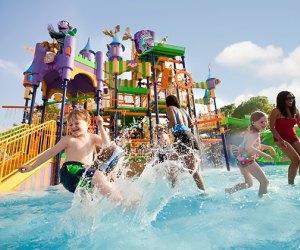 kids splash in water park