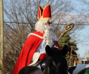 Sinterklass arrives on horseback at the Wyckoff Farmhouse Museum's Dutch Christmas Event