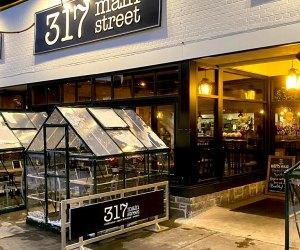 Enjoy outdoor dining in 317 Main Street's mini greenhouses