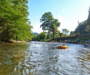 people tubing down a river