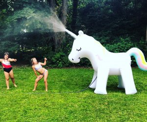 A unicorn sprinkler makes a real splash at a kid party.