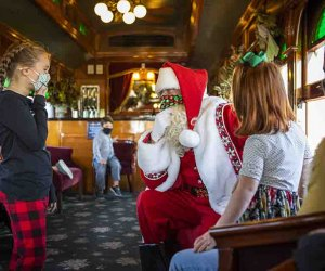Santa Claus welcomes you and passengers of all ages aboard Santa's Paradise Express. Photo courtesy of Strasburg Rail Road