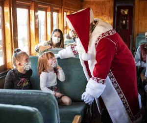 Santa greets girls on a train ride