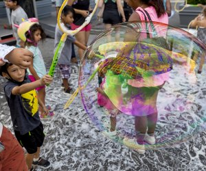 Kids play with bubbles at Summer Streets