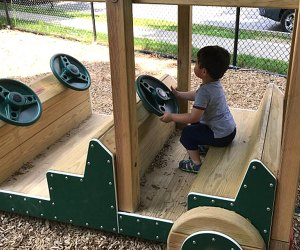 Little ones can take the wheel(s) of the wooden car at Sunset Park. Photo by the author