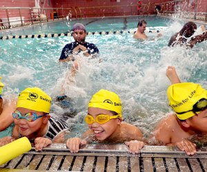 Kids learn to swim for free through the NYC Parks Department.