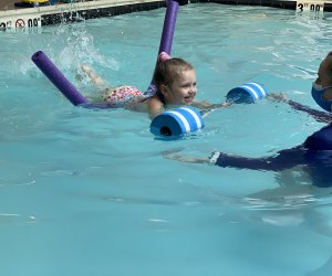 This four-year-old is practicing her strong kicks at SafeSplash Swim School. Photo courtesy of SafeSplash.