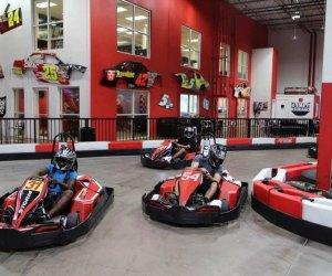 kids drive at an indoor grand prix