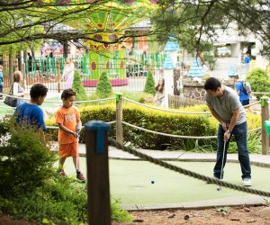 Enjoy some quality family time at The Castle Fun Center's mini golf course.