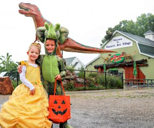 Costumes—especially dinos!—are encouraged at The Dinosaur Place. Photo courtesy of Nature's Art Village
