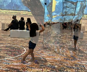 Mirrors put kids right in the middle of the art at Immersive  Van Gogh. Photo by Maureen Wilkey