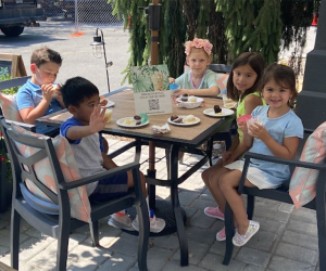 Kids gather around a table at The Compound Coffee Co. in Verona, New Jersey