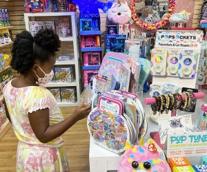 Girl peruses the toys at Learning Express in Verona, New Jersey