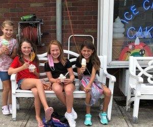 Kids enjoy ice cream cones in front of Verona's The Towne Scoope shop