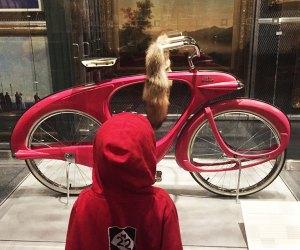 boy looking at bicycle art