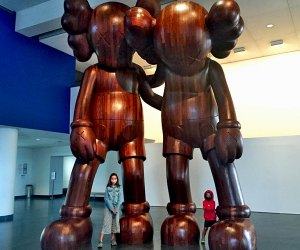 Strike a pose with the giant KAWS sculptures at the Brooklyn Museum.