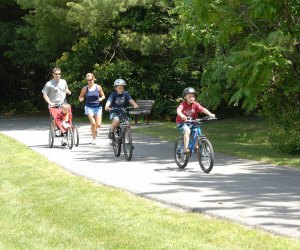 family biking on path Westchester North County Trail