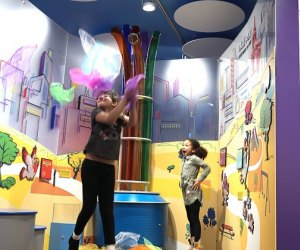 Girls play indoors at CMOM's Superpowered Metropolis