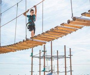 Child crosses a bridge at Wild Play Jones Beach