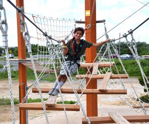 Climb the ropes and ladder courses at WildPlay Jones Beach—if you dare.