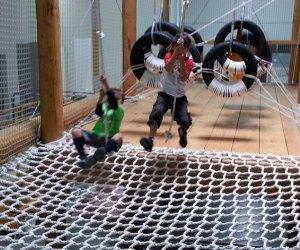 Swinging through the ropes course at Wonderwild
