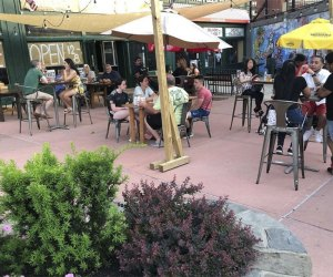 people dining on the patio at yonkers brewing company