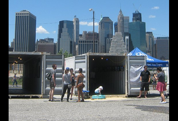 """There's a small inflatable pool outside the """"East River Ferry"""" container"""
