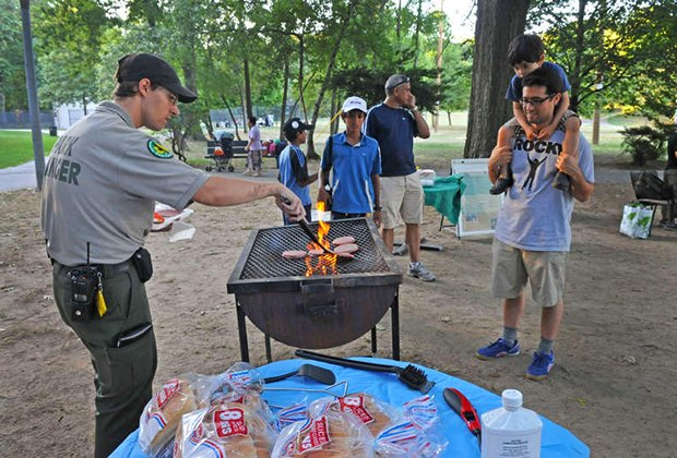 Urban Park Ranger mans the grill at a campout