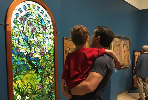 dad and son looking at artwork