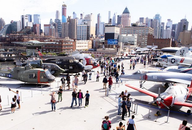 The flight deck of the Intrepid Museum with Midtown Manhattan in the background