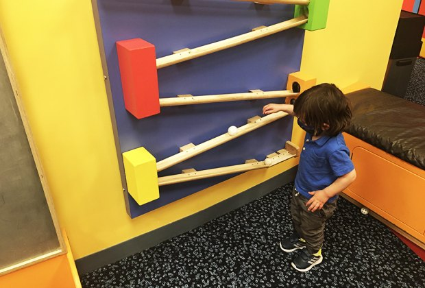 DuPage Children's Museum: balls rolling on wooden wall track