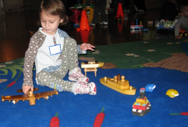 Kids can toy with boats, planes and cars during free play