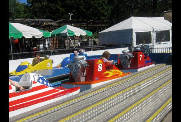 Water splashes on the Hydro Racer ride, as they go around
