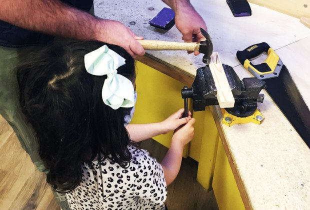 DuPage Children's Museum: girl woodworking