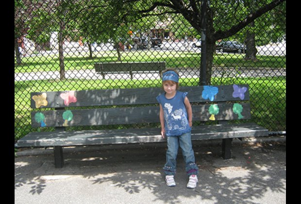 Relaxing on a bench in the Vincent V. Abate Playground