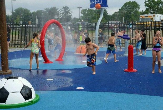 Kids run through water at Manalapan splash pad