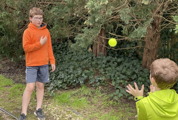 Hiking Games for Kids That Turn Walks into Adventures: kids playing catch with a tennis ball