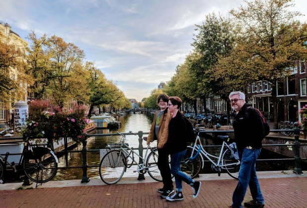 Stroll past Amsterdam's pretty canals on a family vacation to the Dutch city