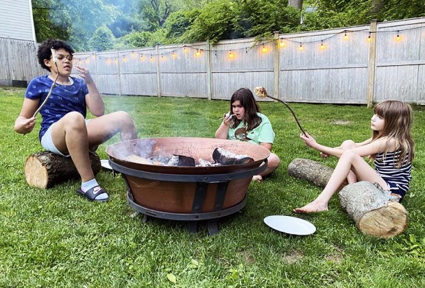 kids around a campfire roasting marshmallows