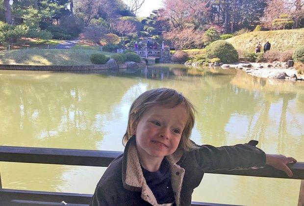 Brooklyn Botanic Garden's The Japanese Hill-and-Pond Garden boy on bridge