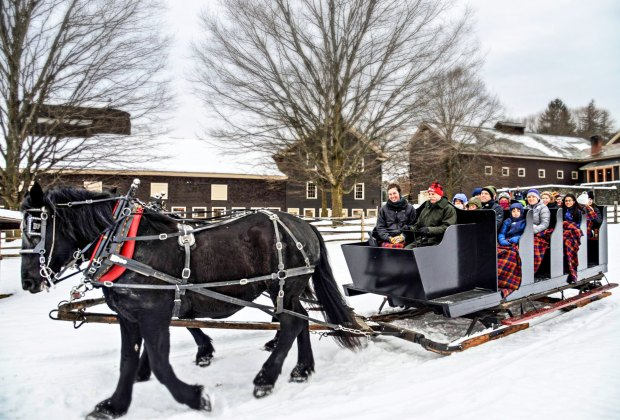 Passengers keep warm with blankets and cider during sleigh rides across snowy pastures. Photo courtesy of Billings Farm