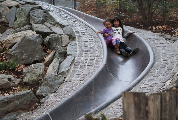 Two girls on granite slide at Billy Johnson Playground in Central Park