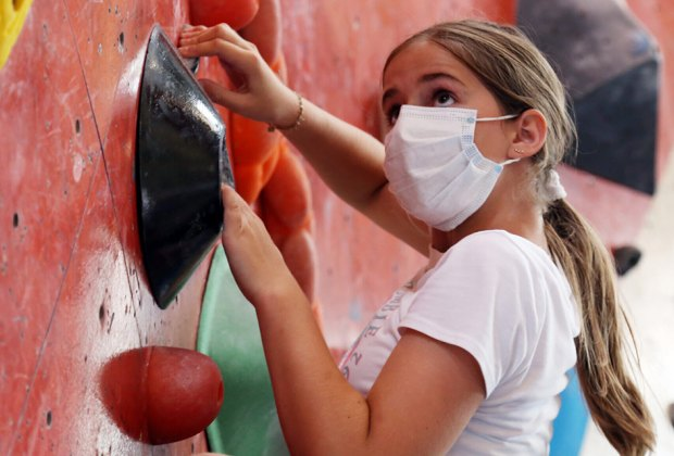 girl indoor rock climbing at Brooklyn Boulders Chicago winter activities for kids