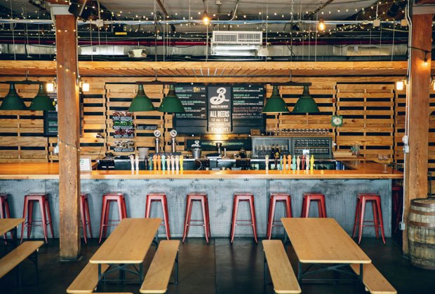indoor beer garden with tables and a bar