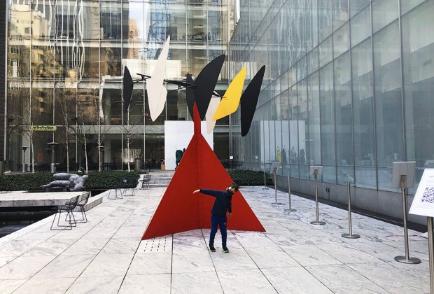 Little boy poses in front of Calder sculpture at MoMA
