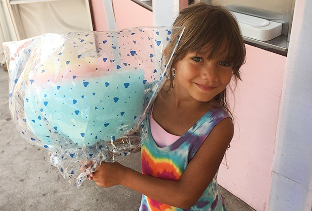 Little girl with over-the-top cotton candy