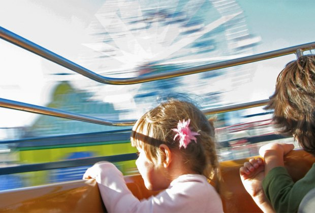 Kids on a Coney Island amusement park ride